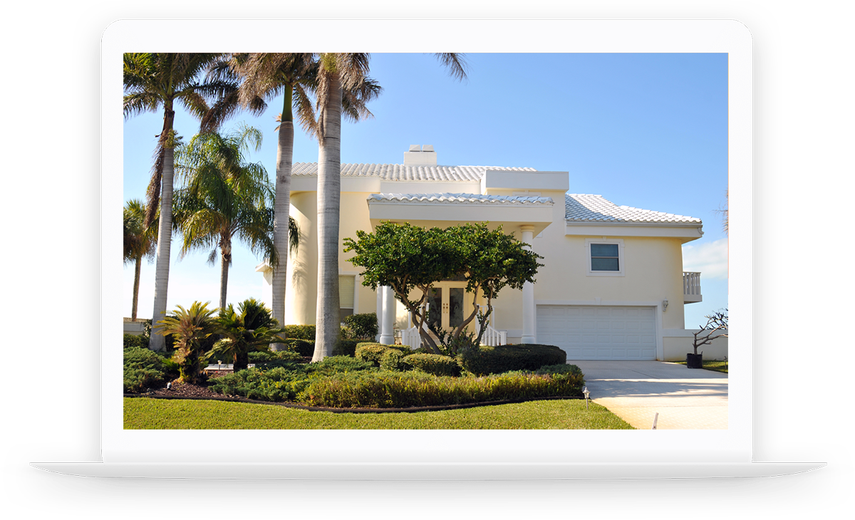 Laptop showing a modern beach house surrounded by palm trees after a home inspection.
